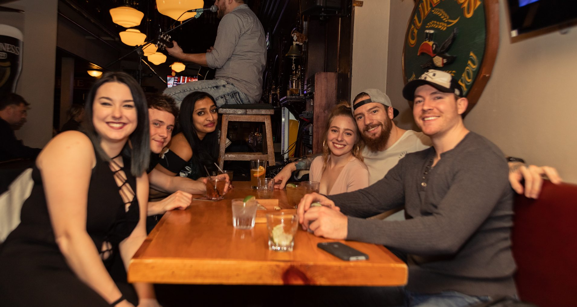 Group Of Friends Enjoying Food And Drinks At An Ottawa Irish Pub